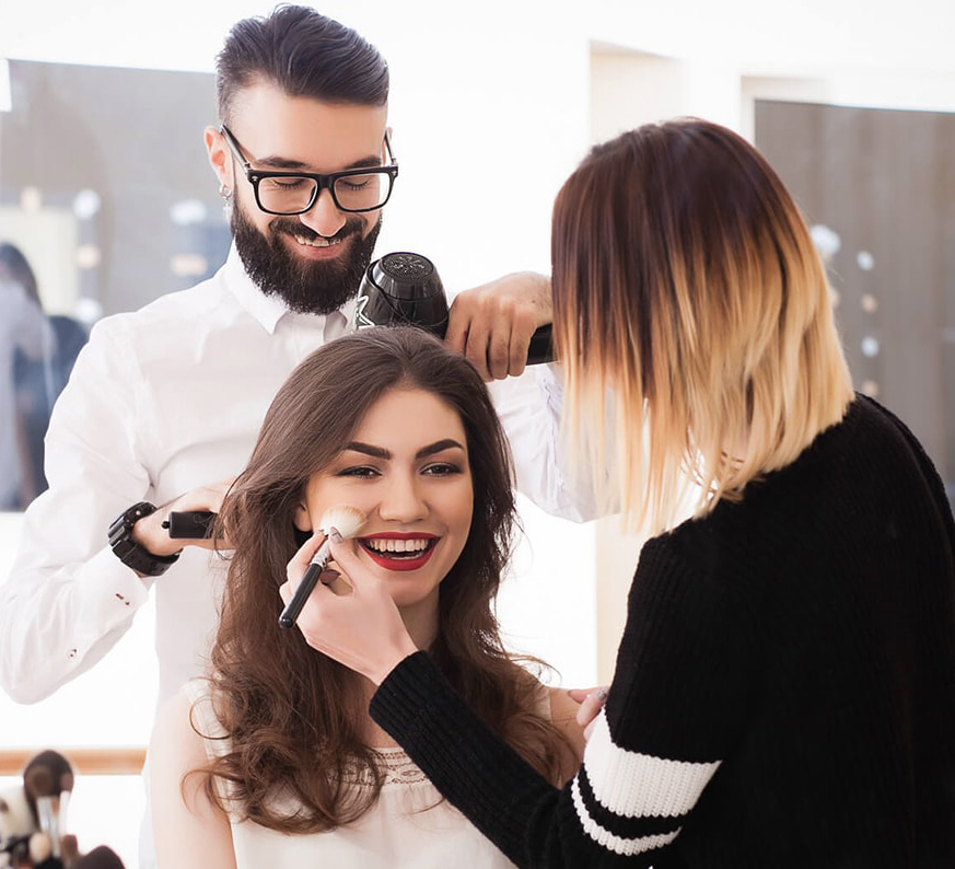 woman having makeup and hair done